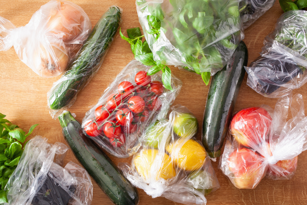 Fruits and vegetables in plastic bags
